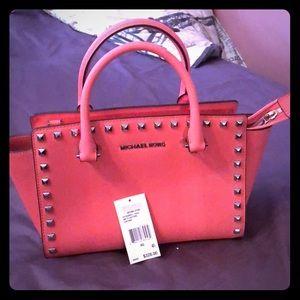 Michael Kors selma studd coral pink bag